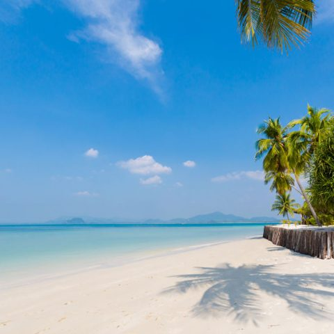Paradise resort on tropical Koh Mook island in Thailand. Landscape taken on Sivalai beach with blue sky and white sand.